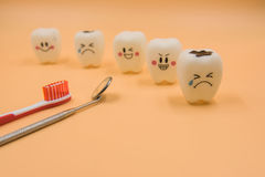 Model Cute toys teeth in dentistry on a yellow background Royalty Free Stock Photo