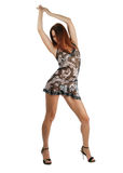Model dancing in short dress with hands risen Stock Photo