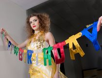 Model decorating birthday party Royalty Free Stock Photography