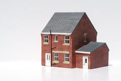 Model of detached house on white background Royalty Free Stock Photos