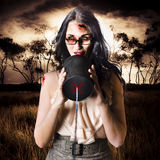 Model in devil makeup announcing Halloween message Stock Images