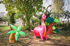 Model dinosaur And trees. In the park royalty free stock photo