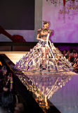 A model displays a glass slipper dress stock images
