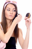 Model does her make-up Royalty Free Stock Photos