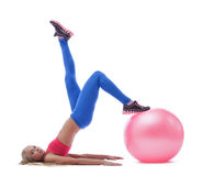 Model doing stretching exercises with fitness ball Royalty Free Stock Images