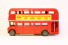 Model of double-decker London bus. Side view of a double-decker London red bus. Model isolated on white Royalty Free Stock Image