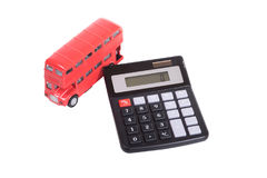Model of a double-decker red bus and calculator Stock Image