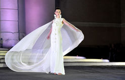 A model dresses with a wedding dress Royalty Free Stock Photo