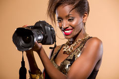 Model with DSLR Camera. Attractive model in studio holding DSLR camera stock images