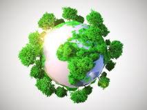 Model of Earth with oversized trees. Stock Images