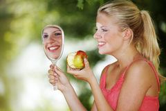 Model eating an apple Stock Photos