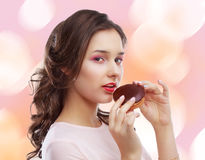 Model eating dessert. Beautiful young model eating dessert, isolated Stock Photo