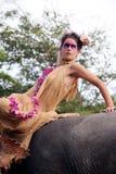 Model and elephant. royalty free stock image