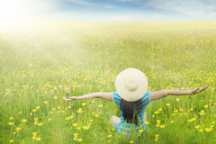 Model enjoy springtime on blossom meadow Stock Photo