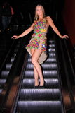 Model on escalator wearing dress Royalty Free Stock Photography