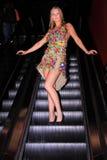 Model on escalator wearing dress royalty free stock photography