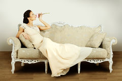 Model in evening gown in retro interior Royalty Free Stock Photography