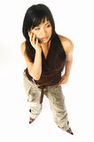 Model expressions with cell. Sexy asian girl model talking cell phone Royalty Free Stock Photos