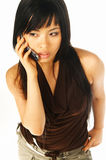 Model expressions with cell. Sexy asian girl model talking cell phone Stock Photography