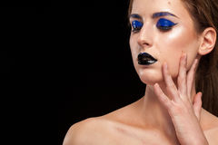 Model with extravagant fashion makeup posing in studio Royalty Free Stock Photos
