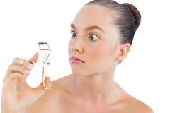 Model with eyelashes curler Stock Photo
