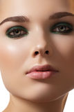 Model face, fashion smoky eye make-up & clean skin Royalty Free Stock Photography