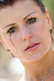 Model face with flowing cosmetics. Beautiful model face with flowing cosmetics, possibly of tears royalty free stock photos