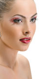 Model face, lips make-up, earring Stock Photography