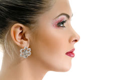 Model face, lips make-up, earring Royalty Free Stock Photos
