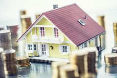 Model familly house with coins as bank or insurance concept.  stock images