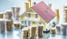 Model familly house with coins as bank or insurance concept.  royalty free stock images
