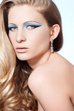 Model with fashion make-up, long blond curly hair Royalty Free Stock Photos