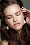 Model with fashion make-up, long hair and jewelry Stock Image