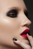 Model with fashion make-up, manicure & vinous lips. Portrait of luxury woman model with dark catwalk fashion make-up, black manicure and dark magenta lips on stock image