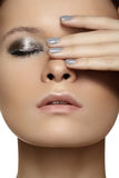 Model with fashion shiny make-up & nails manicure Stock Image