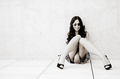 Model at fashion sitting on the floor Royalty Free Stock Image