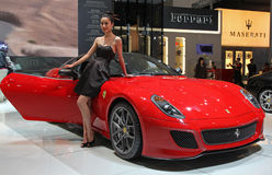 Model and Ferrari 599 GTO royalty free stock images