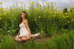 Model In Field Of Flowers Royalty Free Stock Photography