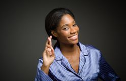 Model fingers crossed wishing lucky Royalty Free Stock Images