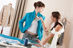 Model fitting by female fashion designer Stock Photography
