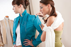 Model fitting by female fashion designer Royalty Free Stock Photos