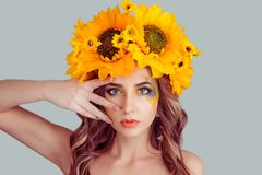 Model in floral headband touching her face skin around eyes stock photo
