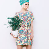 Model with flower in trendy summer dress Royalty Free Stock Images