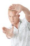 Model framing his face Stock Image