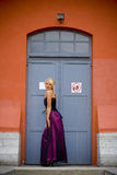 Model in front of door Royalty Free Stock Photography