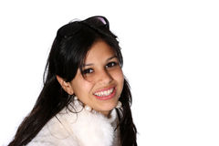 Model in fur coat. Portrait of attractive young woman in a white fur coat and shades Stock Images