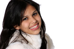 Model in fur coat. Portrait of attractive young woman in a white fur coat Stock Image