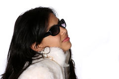 Model in fur coat. Portrait of attractive young woman in a white fur coat and shades stock photos
