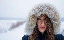 Model in fur hat with snowflakes on it Stock Image