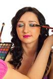 Model getting eyeshadow make up Stock Image